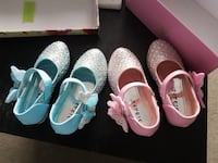 two pairs of mary jane flat shoes