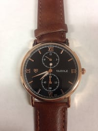 Round gold chronograph yazole watch with brown leather strap