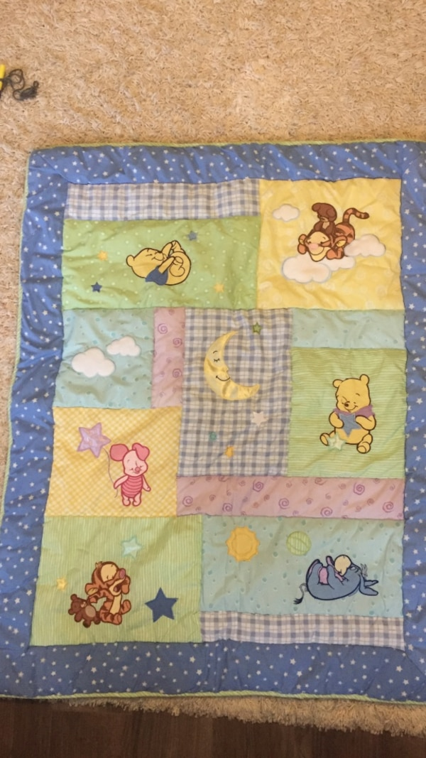 Winnie the Pooh Baby blanket-White, blue, and green floral textile