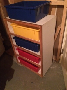 Shelf with 5 colourful bins