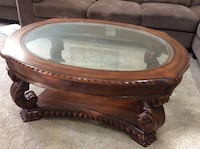 Brown wooden framed glass top coffee table Pleasanton, 94588
