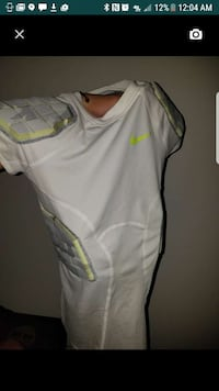 white and green Nike padded shirt Maryland