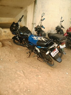 black and blue standard style motorcycle