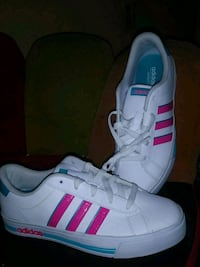 white-and-pink Adidas low-top sneakers