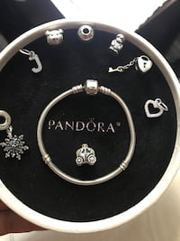 Authentic pandora bracelet with 8 charms  Mississauga, L5H 3S4