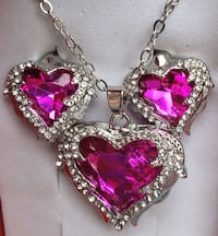 Luxury pink colored angel wings locket necklace and earrings