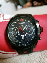 Black Curren watch with red detailing.