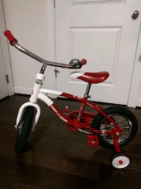 toddler's red and white bicycle with training wheels Herndon, 20171