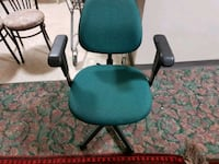black and green rolling chair