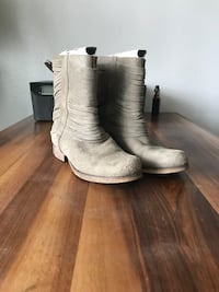 pair of gray suede mid-calf boots