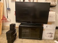65 inch TV, Stand, and Home theater speakers