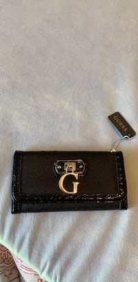 Guess wallet black. Brand new with tags. Makes a lovely gift ! Shelby Township, 48315