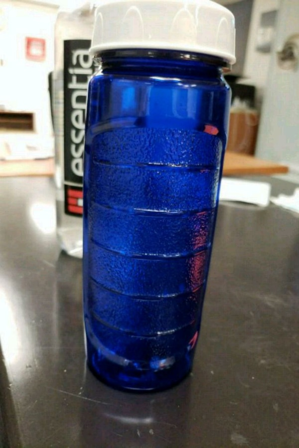 blue and black plastic bottle