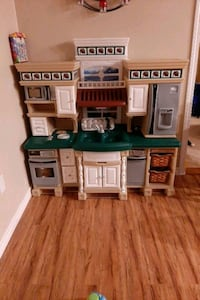 Toy kitchen with food and accessories