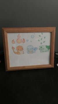 rectangular brown wooden-frame with three Pokemon character print