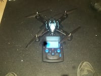 black and teal quadcopter