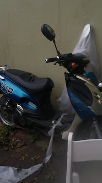 blue and black motor scooter null