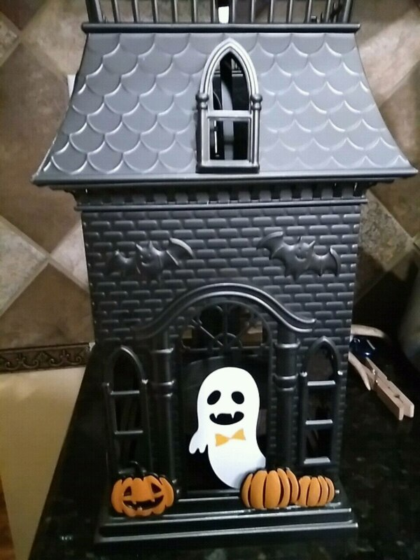 Haunted house candle holder