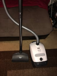 white and black canister vacuum cleaner Rockville, 20851