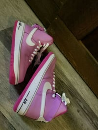 pair of pink-and-white Nike Air Force 1 high shoes
