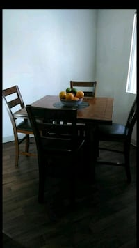 rectangular brown wooden table with six chairs din Tucson, 85714