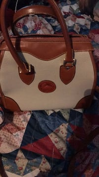 The real deal dooney and bourke never been used ..was $525  Port Orange, 32127