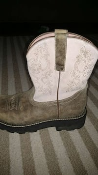 unpaired white and brown suede cowboy boot