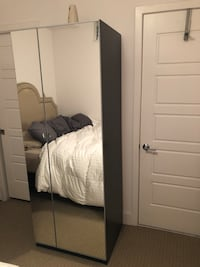 IKEA PAX dark brown wardrobe with mirror. Hanging rod and storage basket included for inside   27 mi