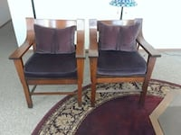 two brown wooden framed purple padded armchairs Eagan