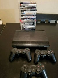 black Sony PS3 slim console with controllers and g 1518 mi