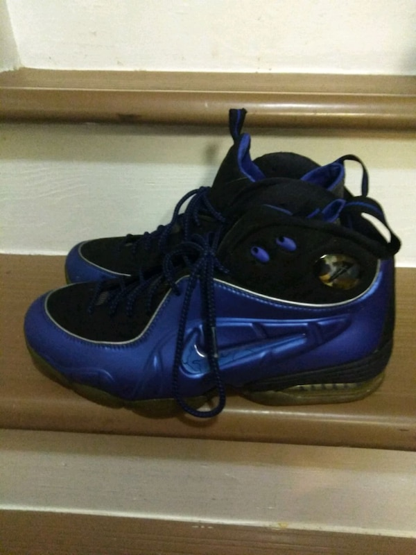 pair of black-and-blue Nike basketball shoes 5b4fc012-2252-40cb-a876-aff955885575