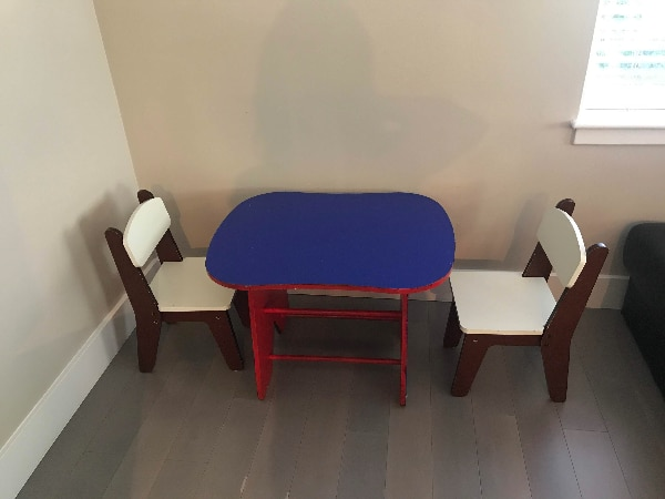 Children's wooden table with two chairs.
