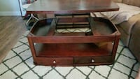 Wood Coffee table that lifts and has drawers. Port Richey
