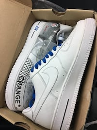 pair of white Nike Air Force 1's OBAMA