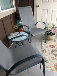 Patio set with glass top table and two chairs