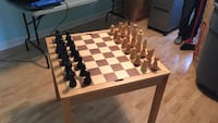 brown and black wooden chessboard table set Chicago Ridge, 60415