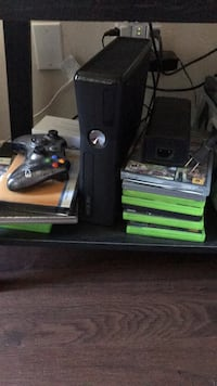 black Xbox 360 console with controller and game cases Camarillo, 93010