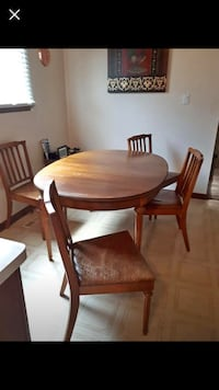 round brown wooden table with four chairs dining set Pickering, L1W