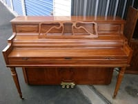 brown wooden upright piano with chair 2246 mi