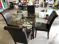 Glass top table w/ 4 leather chairs Edmonton, T5Z 3K5