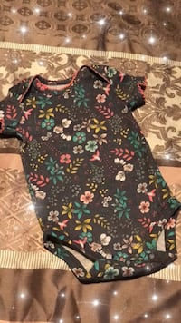 Black and multicolored floral onesie