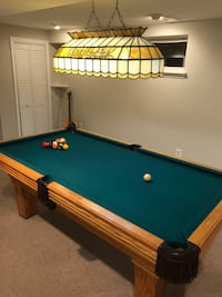 Pool table and matching billiards light.  Excellent condition.  Comes with fitted mats to cover felt, slip cover, custom que, sticks, holders, racks for 12 & 9 ball and a box of chalk. Great condition and comes with padding for felt and cover slip over th Alexandria, 22302