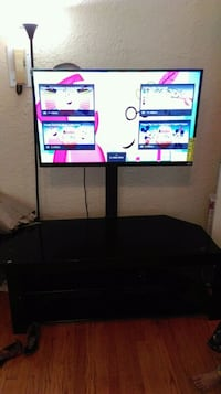 black flat screen TV with black wooden TV stand Franklin, 53132