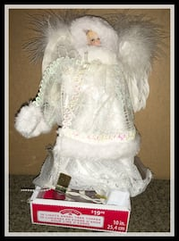 white and pink dressed doll 537 km