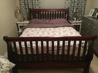 Double sleigh bed frame. Dark cherry wood.  3733 km