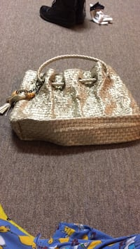 Gold wicker leather drawstring bag