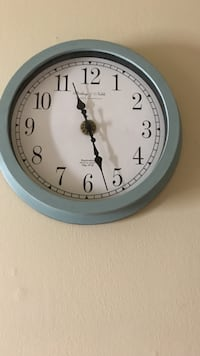 blue and white analog wall clock