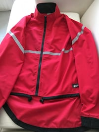 MEC Ladies Running Jacket. Size Large. Zippered pocket in the Back. Zippers on each Side. Valcro on Sleeves. Great Condition.  Cochrane, T4C 1K6
