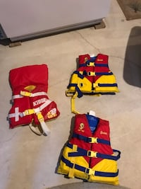 three red and yellow life vests