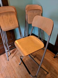 Five brown wooden folding chairs Minneapolis, 55405